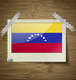 Flags Venezuela at frame on wooden texture vector image vector image