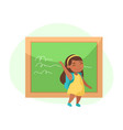 little girl stand at blackboard waving hand vector image