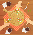 people sitting at table and eating pizza together vector image