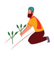 indian farmer man kneeling and holding crop plant vector image vector image