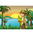 A boy with a parrot at the riverbank vector image vector image