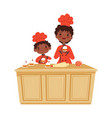 mother and son cooking cakes time bakery vector image