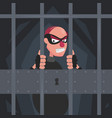 a picture of a thief in a mask in prison behind vector image vector image