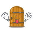 tongue out vintage wooden door on mascot cartoon vector image