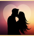silhouette couple kissing on a heart background vector image vector image