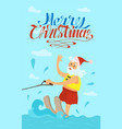 merry christmas santa claus riding on water skies vector image vector image