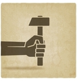 working symbol hand with hammer old background vector image vector image