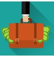 Businessman hand holding briefcase full of money vector image