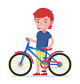 boy standing next to a colorful children bicycle vector image