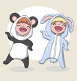 cute children wearing a rabbit and panda costume vector image vector image