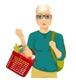young man holding a full shopping basket vector image vector image