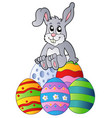 bunny on pile of easter eggs vector image vector image