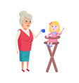 grandmother feeding granddaughter in high-chair vector image vector image