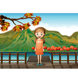 A young girl standing in the middle of the wooden vector image vector image