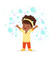 cute happy little girl playing bubbles vector image vector image