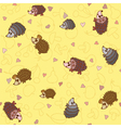 Seamless pattern with cute little hedgehogs vector image