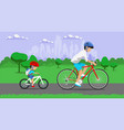 father and son riding bikes in town park vector image
