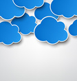 Paper blue clouds on grey vector image