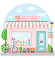 flower shop building facade with bicycle vector image vector image