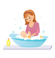 mom washes the baby in the bathisolated on white vector image vector image