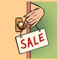 sale woman hand hangs a sign on door vector image vector image