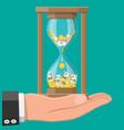 money with hourglass clock in hand vector image vector image
