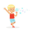cute little blonde boy blowing bubbles vector image vector image