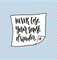 never lose your sense of wonder hand lettering vector image vector image