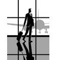 businessman carrying a luggage at the airport vector image vector image
