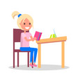 profile of smiling girl sitting at desk with book vector image vector image