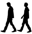 silhouettes of men walking vector image vector image
