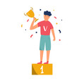 young champion standing with a trophy on pedestal vector image