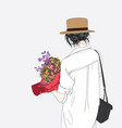 a woman holds many flowers for a large gift vector image vector image