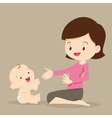 mother playing with baby vector image