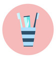 blue flat toothpaste and two brushes in glass icon vector image vector image