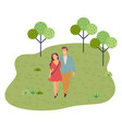 young couple walks in park embracing girl in vector image vector image