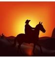 Cowboy on sunset background vector image