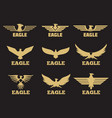 gold heraldic eagles logo collection on black vector image