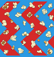 seamless pattern with popcorn on a blue and red vector image