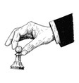 artistic drawing of hand holding chess pawn figure vector image
