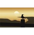 Bird at sunrise scenery vector image