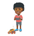 african boy playing with a radio-controlled car vector image vector image