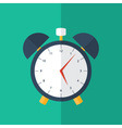 Blue alarm clock icon over green vector image