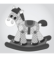 Old rocking horse vector image