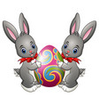 two cute rabbits holding easter egg on a white bac vector image
