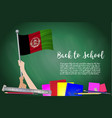 flag of afghanistan on black chalkboard vector image