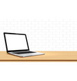 laptop on table against white wall vector image vector image