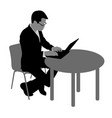 black silhouette man sitting behind computer on a vector image
