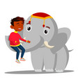 elephant holds a indian boy on trunk vector image