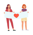 two young smiling girls holding poster with heart vector image